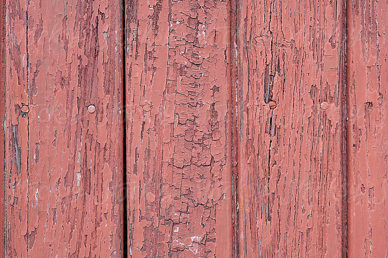 Red paint on an old door by Bisual Studio for Stocksy United