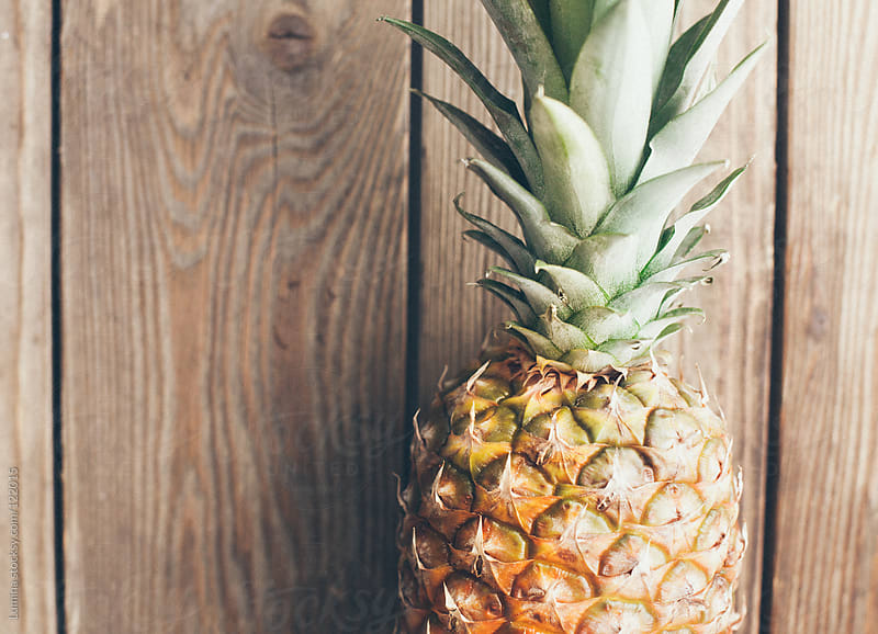 Pineapple on Wood by Lumina for Stocksy United