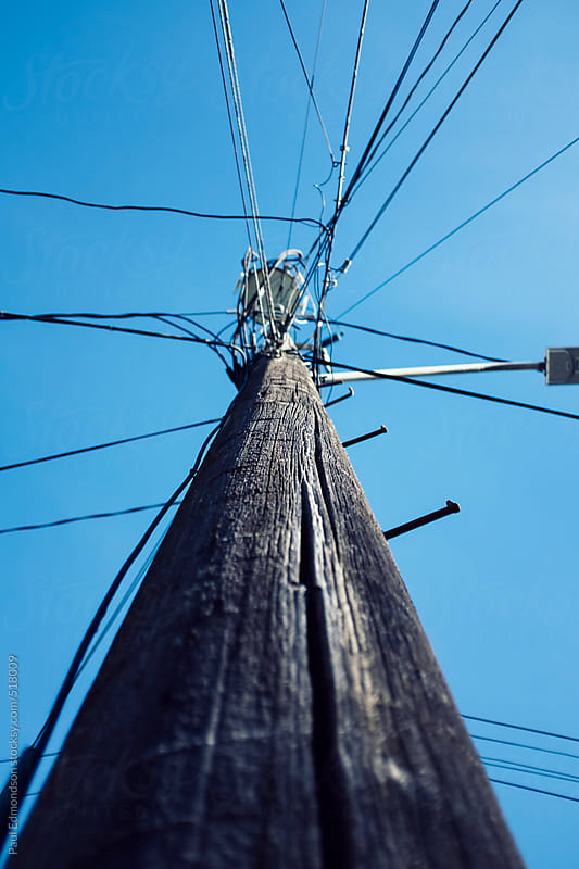 Telephone pole and cables by Paul Edmondson for Stocksy United