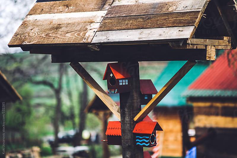 Handmade colorful wood birdhouse by Koki Jovanovic for Stocksy United
