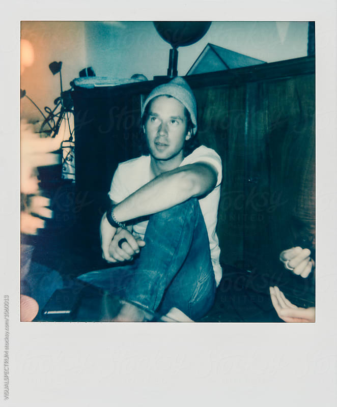 Instant Photograph of Young Hipster With Beanie Sitting on Floor by Julien L. Balmer for Stocksy United