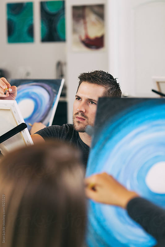 Painting: Man In Group Creating Art During Class by Sean Locke for Stocksy United