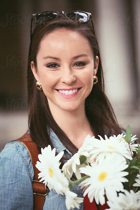 Portrait of Cute Girl with Flowers by Aila Images for Stocksy United