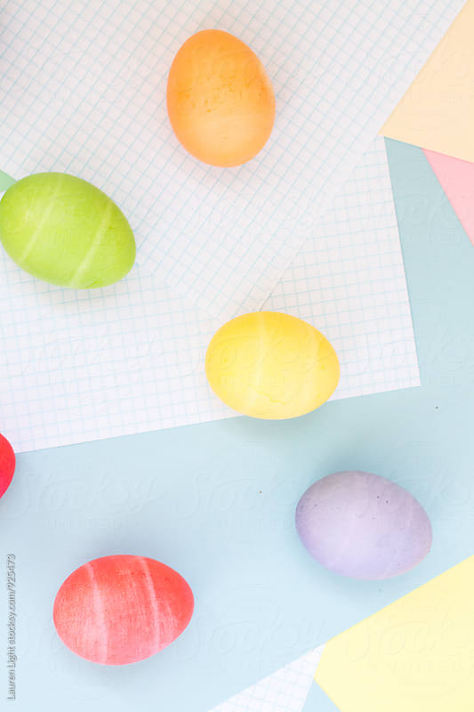 Pastel easter eggs on colorful background by Lauren Light for Stocksy United