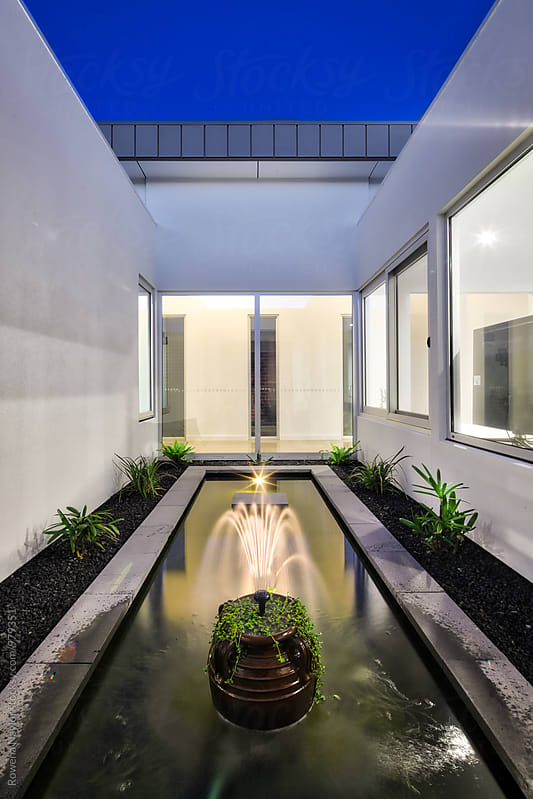 Interior courtyard of architect designed home by Rowena Naylor for Stocksy United