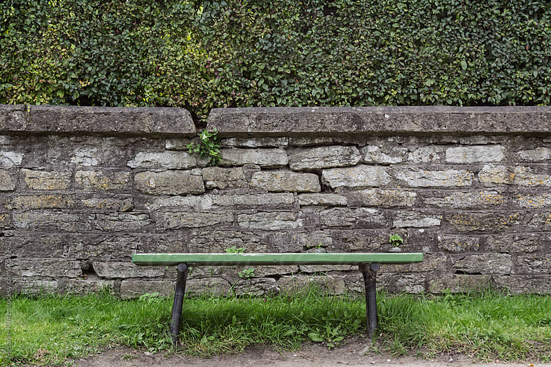 Empty green bench in a park by Melanie Kintz for Stocksy United