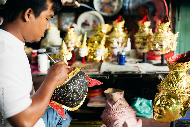 Local artist working on 'Hua Khon' traditional mask for Thai performing arts by Nabi Tang for Stocksy United