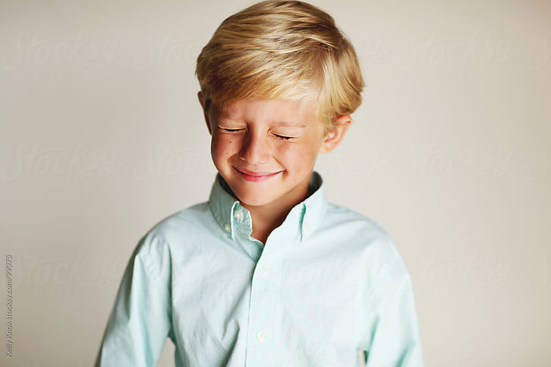 laughing boy with eyes closed by Kelly Knox for Stocksy United