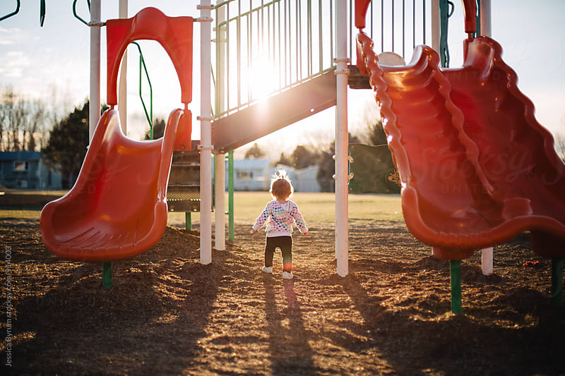 Toddler walking in playground by Jessica Byrum for Stocksy United