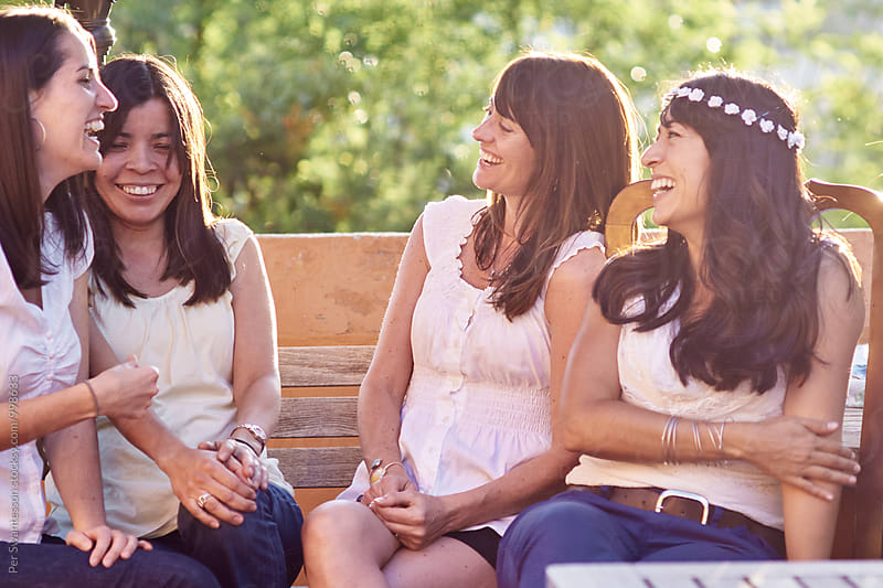 Group of happy female friends at a outdoor summer party by Per Swantesson for Stocksy United