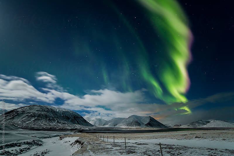 Aurora Borealis in Western Iceland by Reece McMillan for Stocksy United