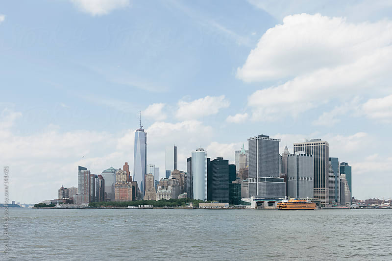 View of South End of Manhattan from Ferry by Joselito Briones for Stocksy United