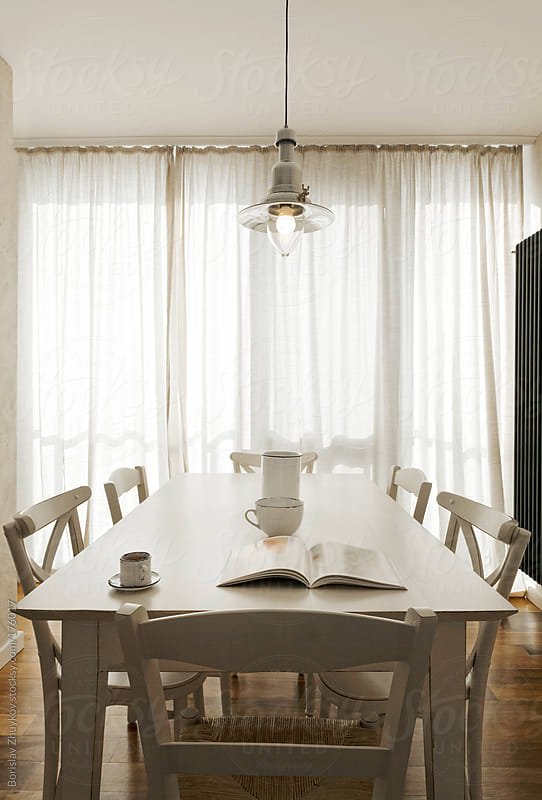 Modern kitchen table by Borislav Zhuykov for Stocksy United