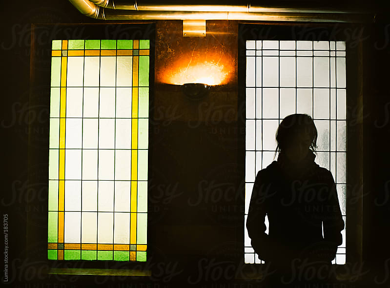 Silhouette of a Woman by the Window by Lumina for Stocksy United
