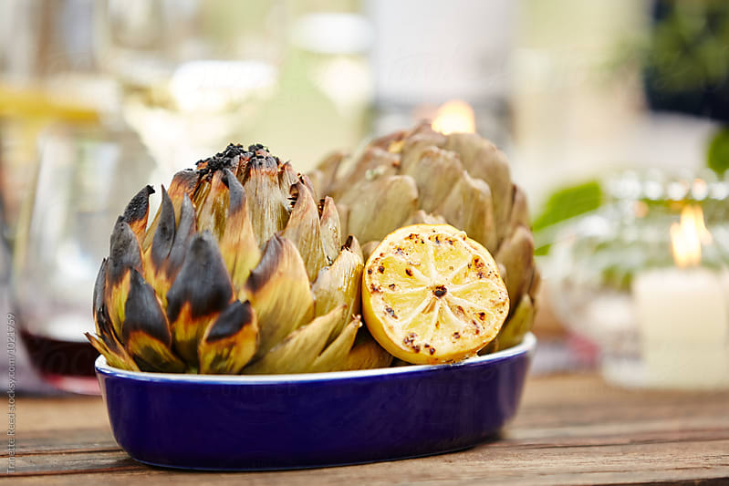 Grilled artichokes with lemon by Trinette Reed for Stocksy United