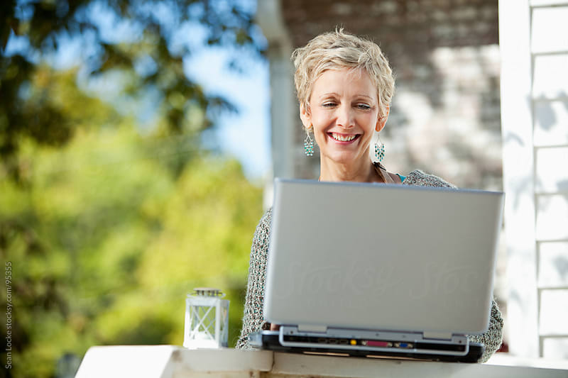 Shop: Using A Laptop Outside to Do Work by Sean Locke for Stocksy United
