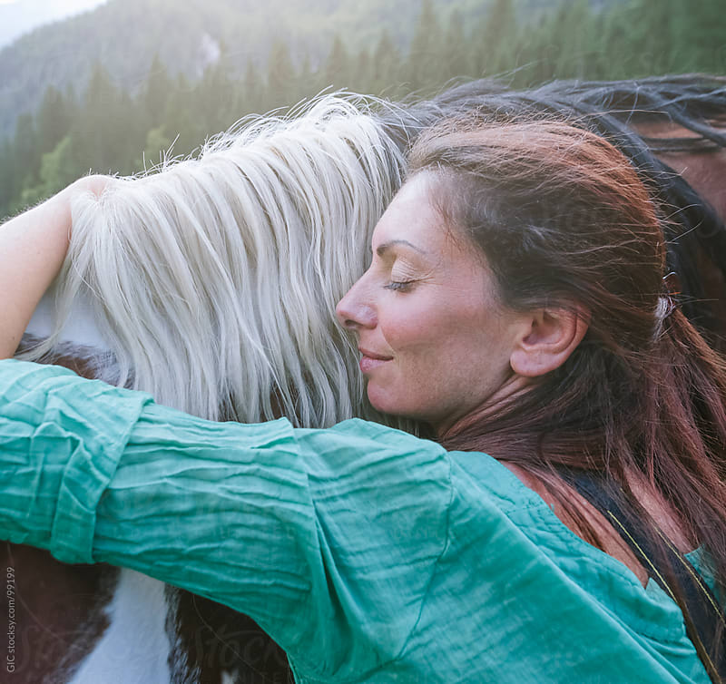 Woman embracing an horse by GIC for Stocksy United
