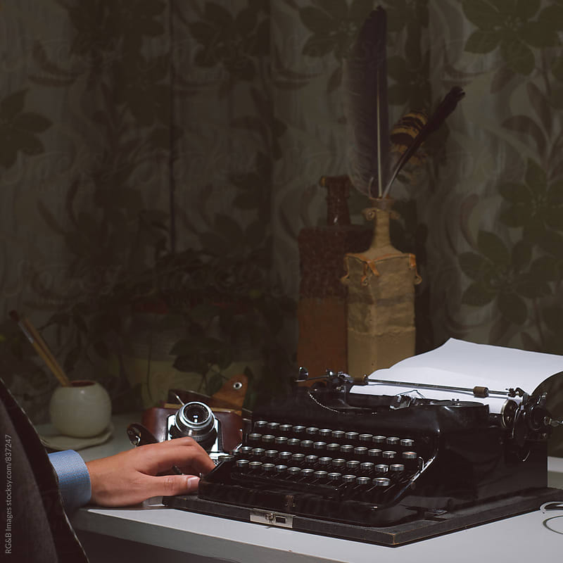 Vintage writer sitting at the typewriter by RG&B Images for Stocksy United