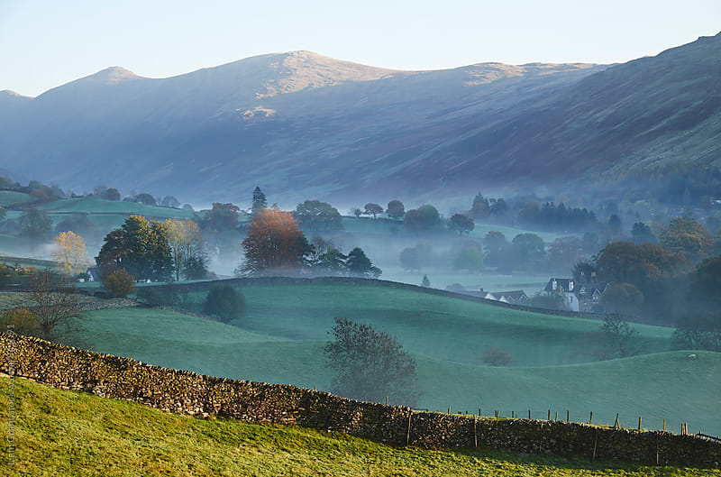 Fog in the valley at sunrise. Troutbeck, Cumbria, UK. by Liam Grant for Stocksy United