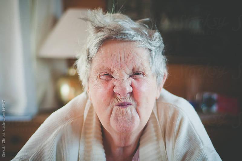 a grandma makes a funny face by Christian Zielecki for Stocksy United