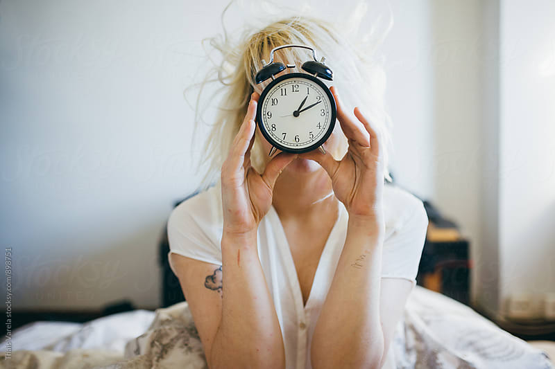 woman just woke up with clock face by Thais Ramos Varela for Stocksy United