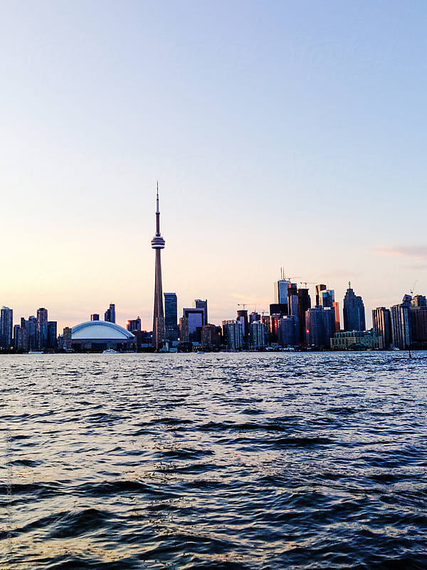 The Toronto skyline as seen from lake Ontario by Chelsea Victoria for Stocksy United