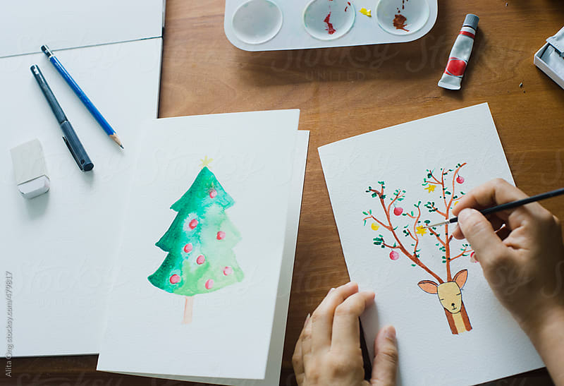 DIY watercolor Christmas card by Alita Ong for Stocksy United