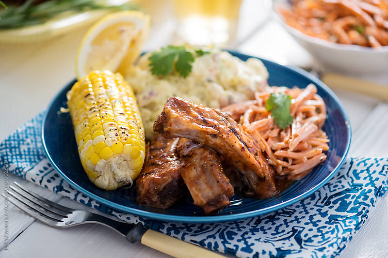Barbecue Ribs and Corn Dinner Party by Jeff Wasserman for Stocksy United