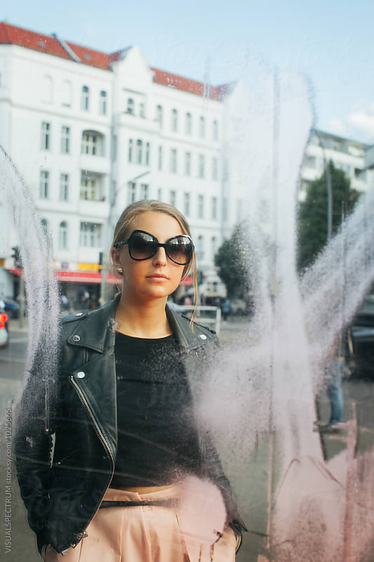 Berlin Street Style - Portrait of Young Fashionable Woman Reflected in Mirroring Facade by VISUALSPECTRUM for Stocksy United