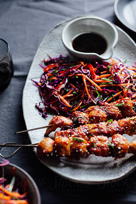 Spicy chicken skewers by Ellie Baygulov for Stocksy United