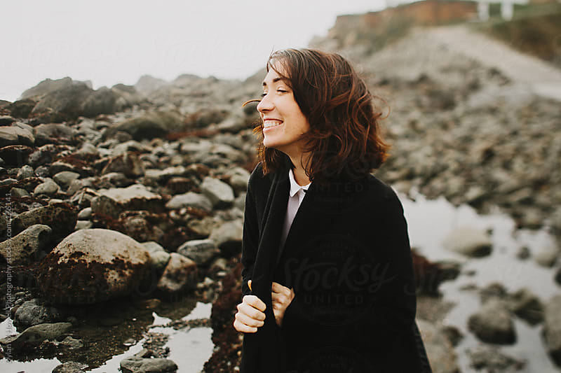 Happy girl at the beach. by Dylan M Howell Photography for Stocksy United