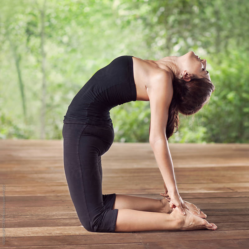 Yoga: Pretty Woman Doing Camel Pose by VISUALSPECTRUM for Stocksy United