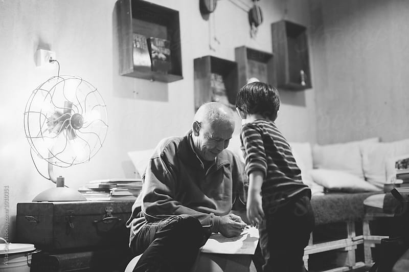 Grandfather spending time with grandson by Alita Ong for Stocksy United