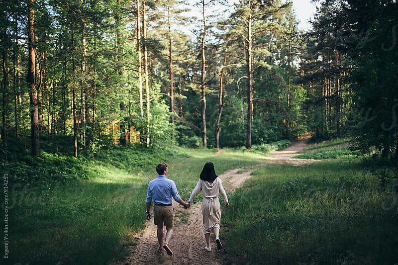 Couple walking in the forest by Evgenij Yulkin for Stocksy United