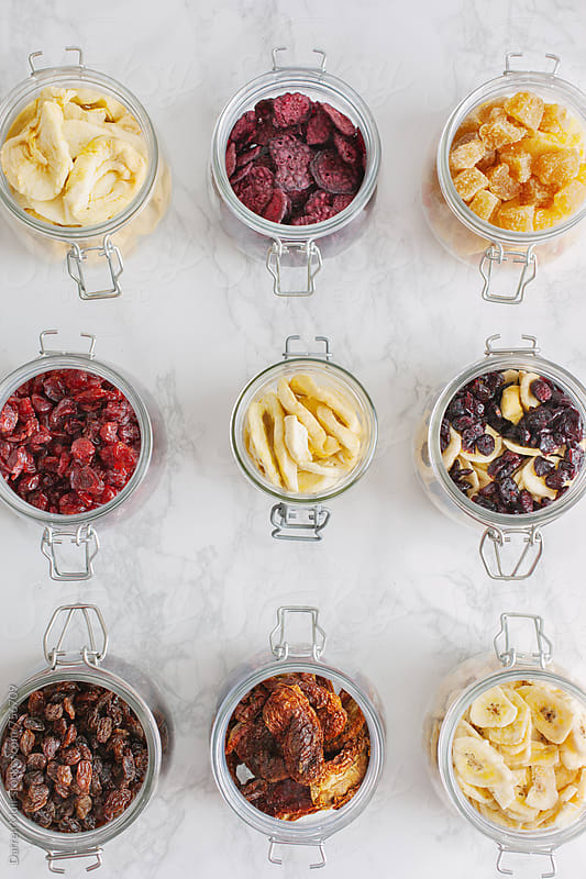 Dehydrated fruit and vegetables in glass jars. by Darren Muir for Stocksy United