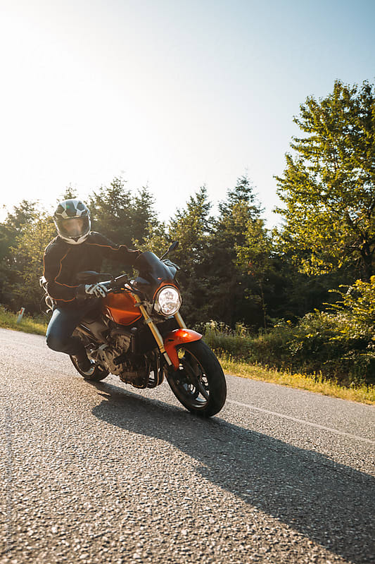 Man ridinig motorcycle by Dimitrije Tanaskovic for Stocksy United