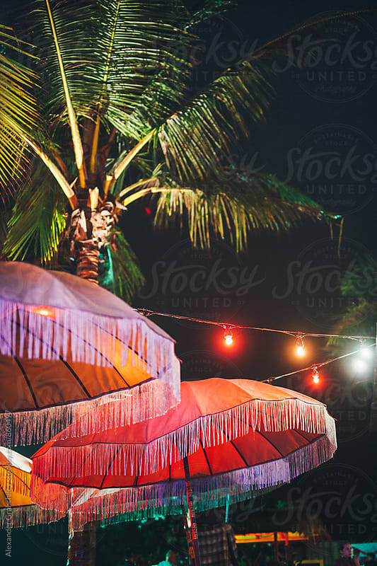 Tropical Evening Cafe With Palms & Garland by Alexander Grabchilev for Stocksy United