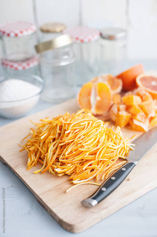 Food: Making of Bitter Orange Marmalade, cutting thin slices by Ina Peters for Stocksy United