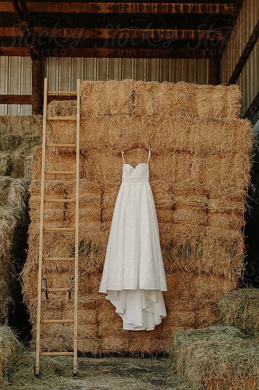 Wedding Dress in Barn by Sidney Morgan for Stocksy United