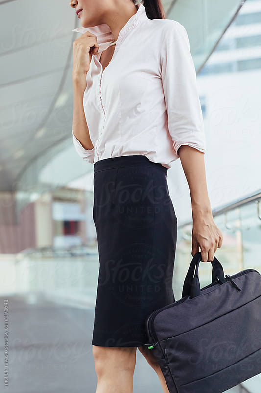 Businesswoman with her briefcase by michela ravasio for Stocksy United