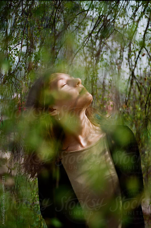A film portrait of a young beautiful woman under the tree by Anna Malgina for Stocksy United