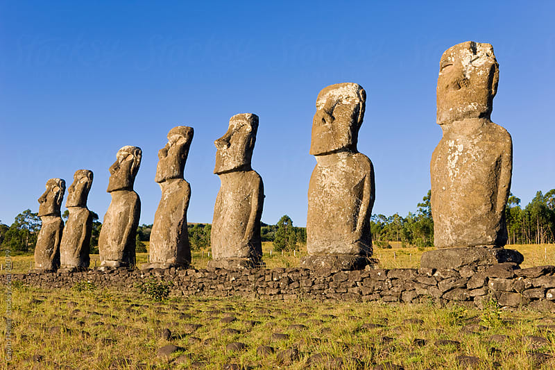 South America, Chile, Rapa Nui, Isla de Pascua (Easter Island), row of monolithic stone Moai statues known as Ahu Akivi by Gavin Hellier for Stocksy United