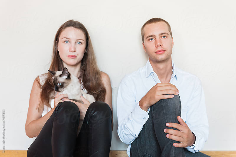 Brother and sister with a cat by Vera Lair for Stocksy United