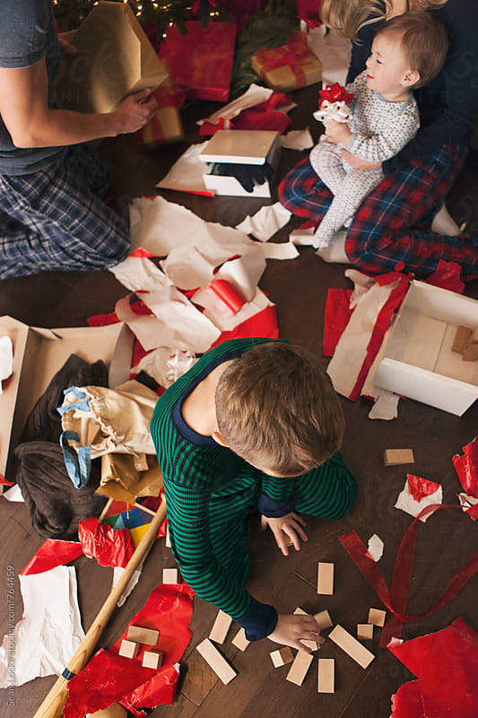 Christmas: Overhead Of Family Opening Christmas Gifts by Sean Locke for Stocksy United
