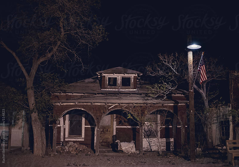Creepy, abandoned house at night by Rachel Bellinsky for Stocksy United