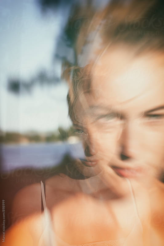 Double exposure portrait of a pretty blonde girl by Marcel for Stocksy United