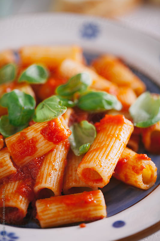Macaroni with tomato sauce by Davide Illini for Stocksy United