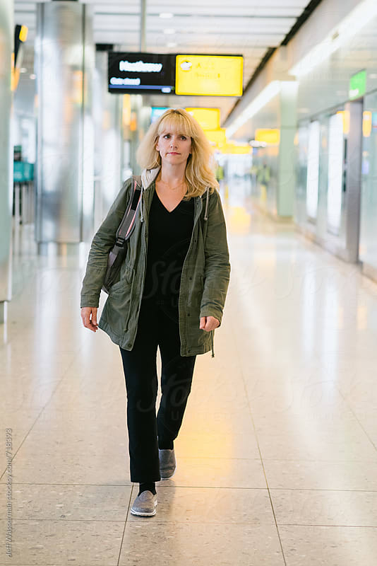 Woman Walking in International Airport by Studio Six for Stocksy United