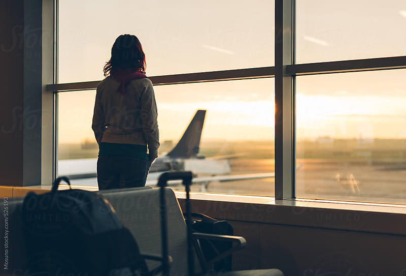 Silhouette of a Woman at the Airport Gate by Mosuno for Stocksy United