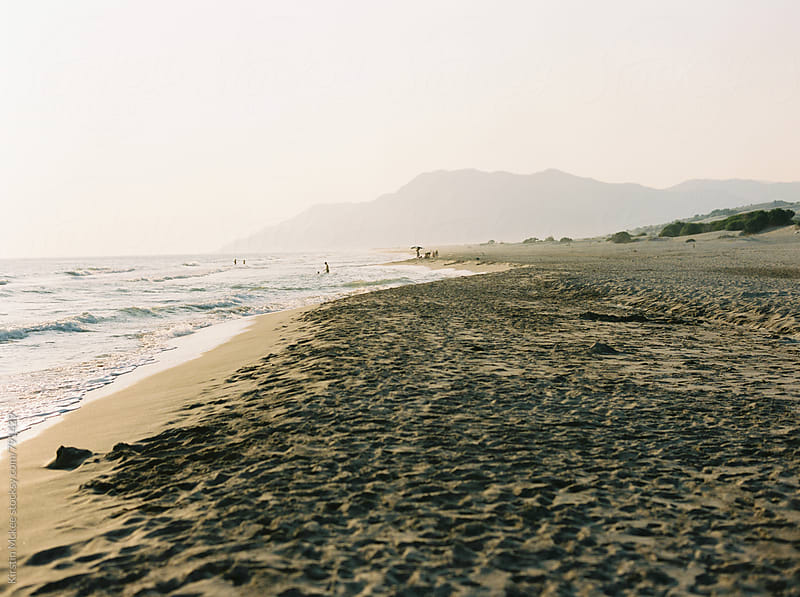 People bathing in the sea at Patara, Turkey by Kirstin Mckee for Stocksy United